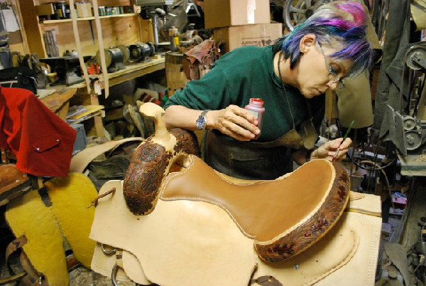 Wendy Allen making a saddle.