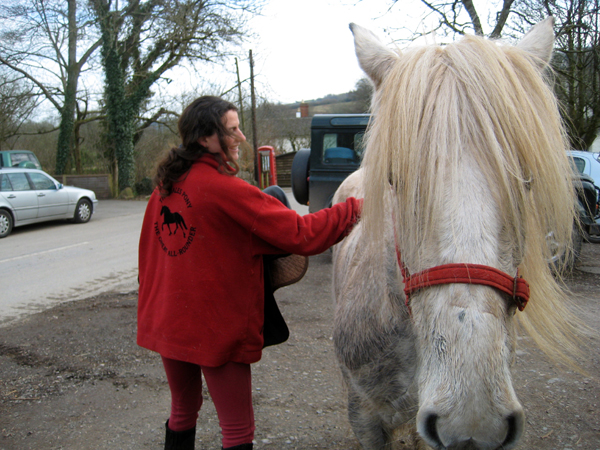 Meg Robbins horse riding on Dales ponies in Devon, UK, at West Steart Farm