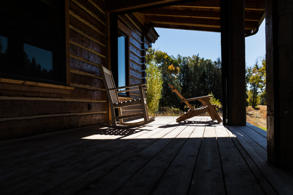 front porch with rocking chairs at double t ranch in montana