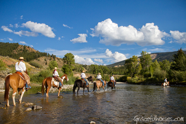 Wranglers crossing the Gros Ventre River