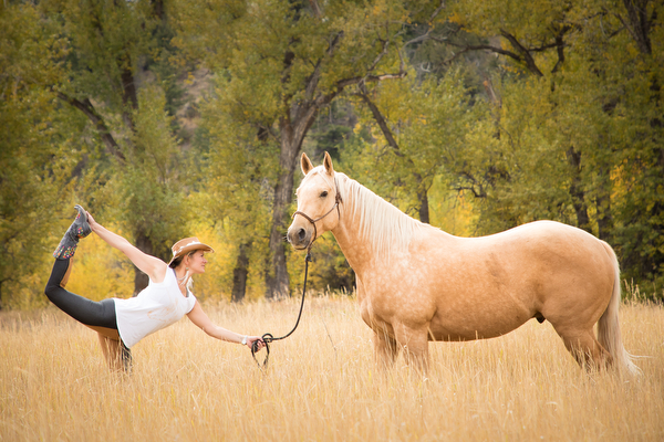 woman in dancer pose with palomino