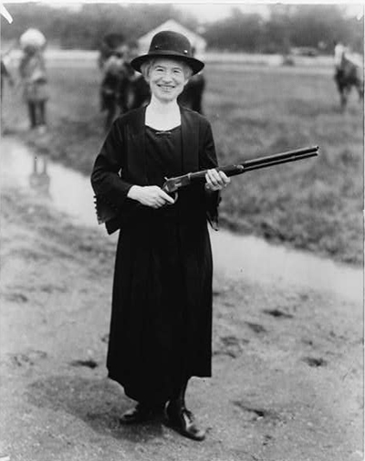 Annie Oakley, with gun Buffalo Bill gave her / staff photo.