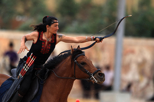 archery on horseback at the al-faris tournament in jordan
