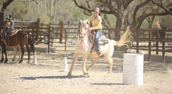 woman at barrel racing lesson at tanque verde ranch in tucson arizona