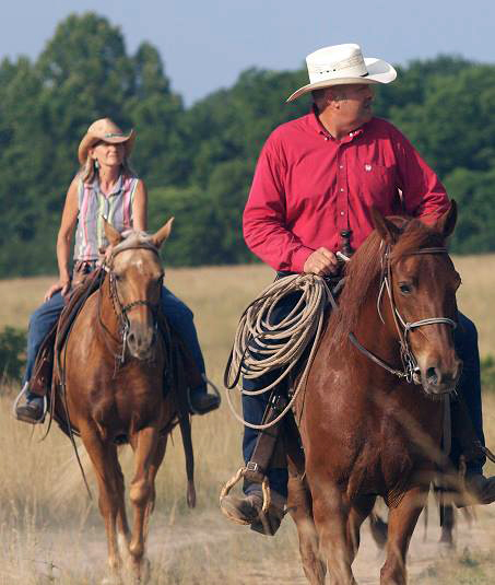 senior couple horseback rides at bucks and spurs guest ranch