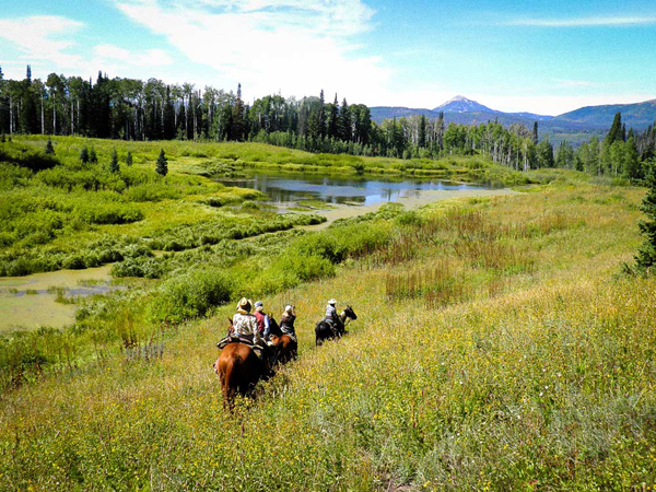 group trail ride on horseback at vista verde guest ranch colorado