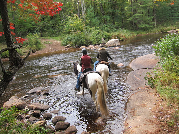 creek crossing on horseback at otter creek