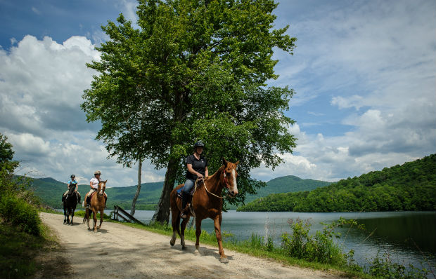 Trail riding by the lake at Mountain Top Resort