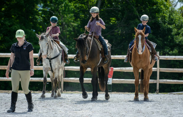 Kids learning to ride Western at Mountain Top Resort