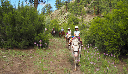 Children riding at Geronimo Ranch