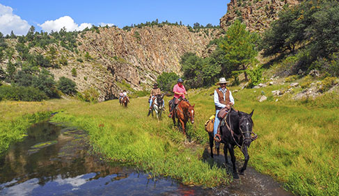 Riding Taylor Creek Canyon at Geronimo Trail Guest Ranch, New Mexico.
