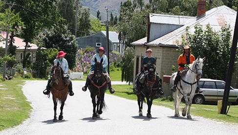 Riding into the old gold mining town of St Bathans Central Otago New Zealand