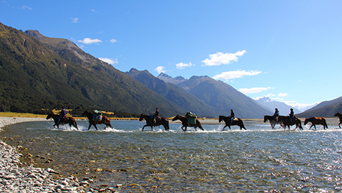 Crossing the Hunter River on Twin Lakes Pack Trail in New Zealand