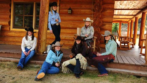 Cowgirls enjoying wine on the ranch porch.
