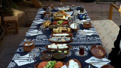 A typical breakfast spread with cheese, fresh bread and jams. You'll have fresh, tasty food throughout your trip.