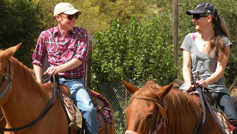 Adults horseback riding at Rankin Ranch, a California dude ranch