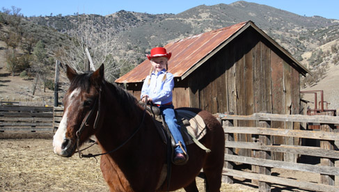 Child riding at Rankin Ranch, California Cattle Ranch & Guest Ranch