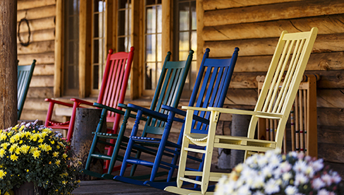Rocking chairs on the front porch at Rawah Ranch