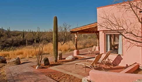 Traditional adobe walls and Santa Fe style architecture perfectly complement the beauty of the natural surroundings.