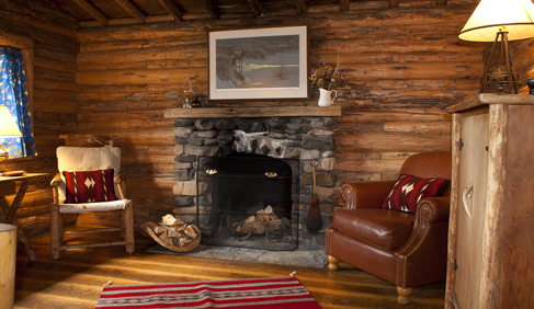 Historic cabins have private baths and comfortable furnishings at T Cross Ranch- Wyoming Dude Ranch.