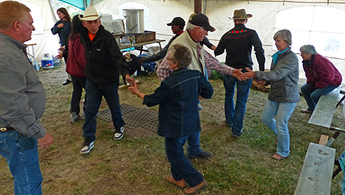 Riders enjoying square dancing after a long day in the saddle