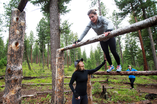 women complete the grizzlyman fitness trail at the resort at paws up