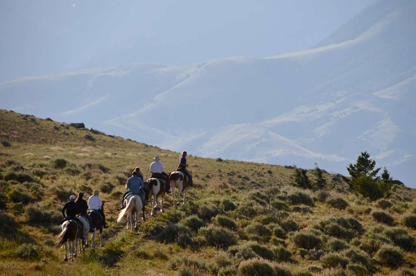 group trail ride at mountain sky guest ranch in montana