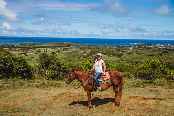 woman riding horse in oahu hawaii at gunstock ranch