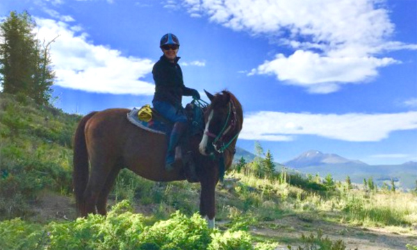 Kate riding her horse in Keystone Colorado