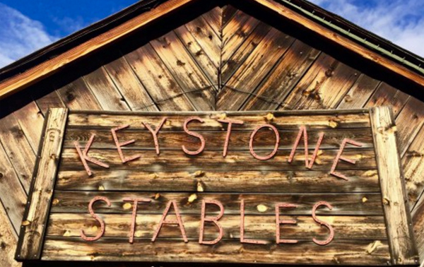 The Keystone Stables sign where visitors can ride horseback in Colorado