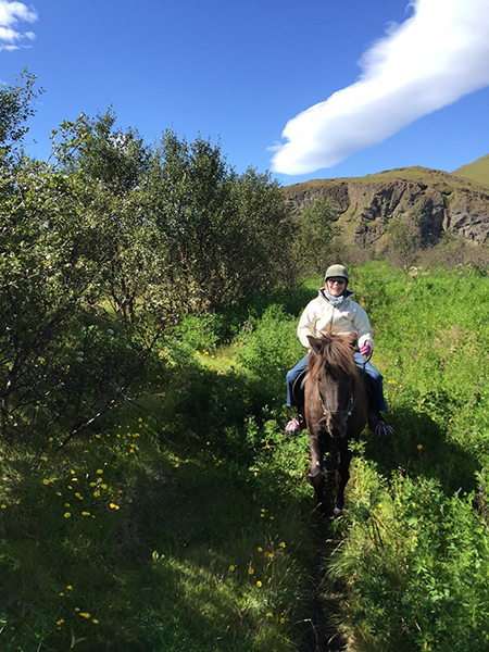 senior woman riding icelandic horse