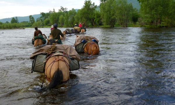 mongolia river crossing horseback