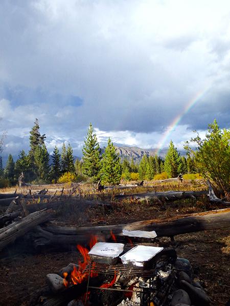 rainbow at thorofare creek at yellowstone national park