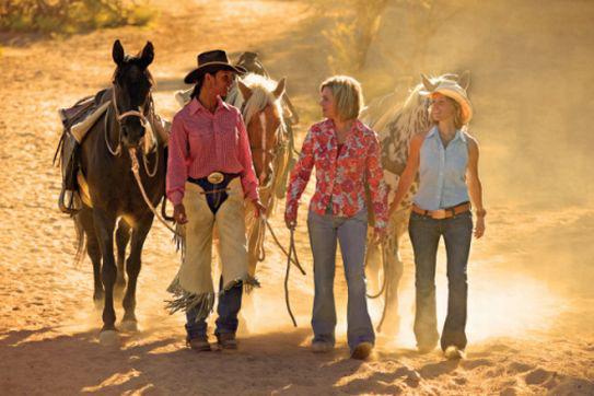 Rancho de los Caballeros cowgirls leading horses