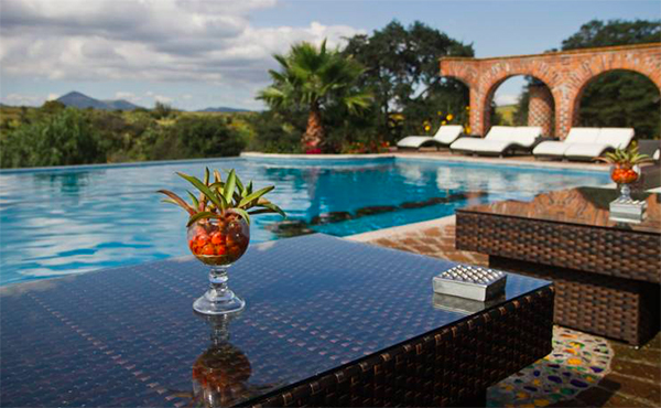 drinks by the pool at rancho las cascadas in mexico