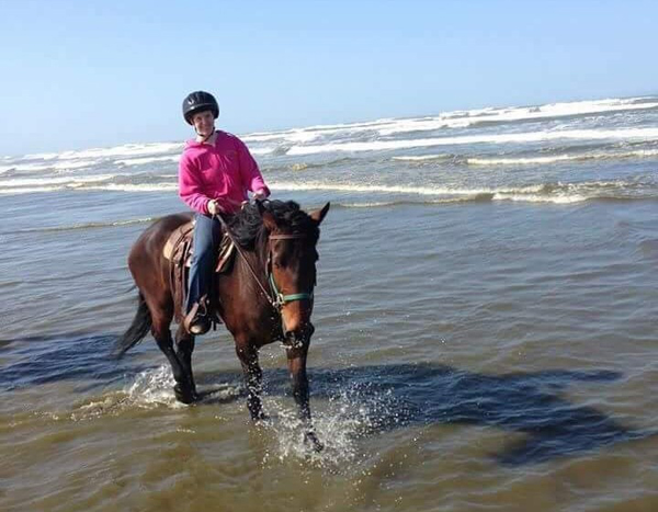 horse and rider in pacific ocean long beach washington