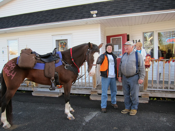 maine horse riding into town for coffee