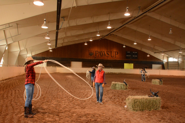 woman in roping lesson at the resort at paws up montana