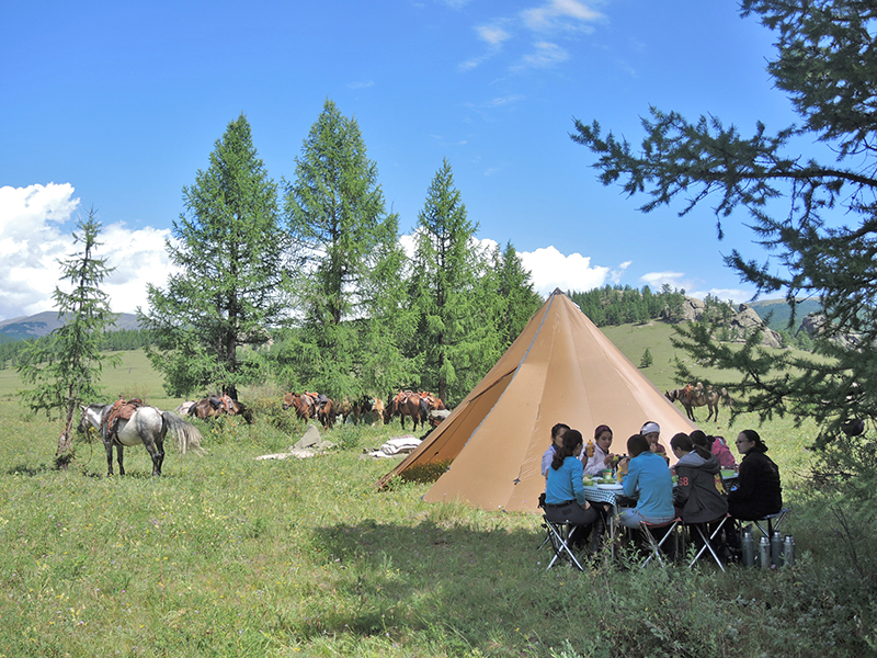 Camping with Stone Horse Expeditions is at scenic sites. Group tents, heated in thecool season, dining tables and pre-dinner wine are part of the signature camping comforts in the wild