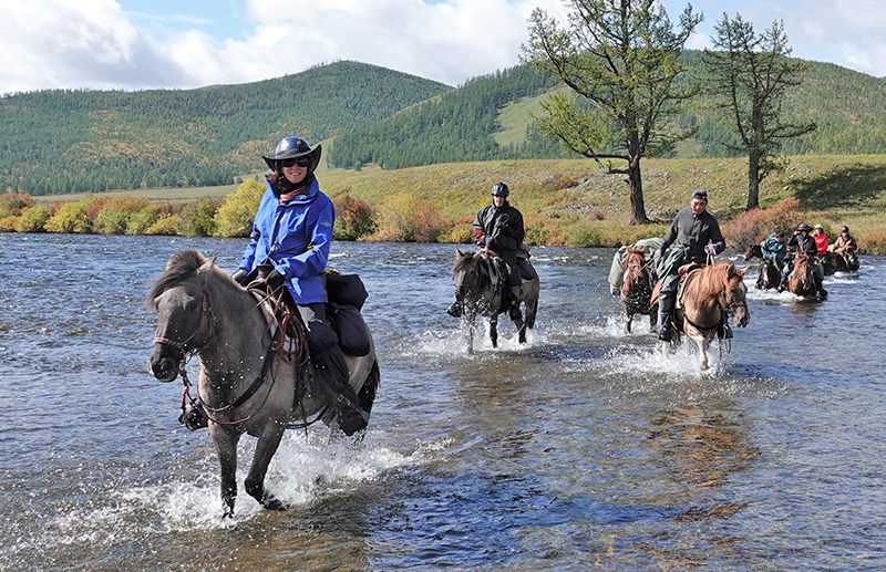 River crossings are part of the riding adventure on the 14 day Khentii Mountains wilderness expeditions