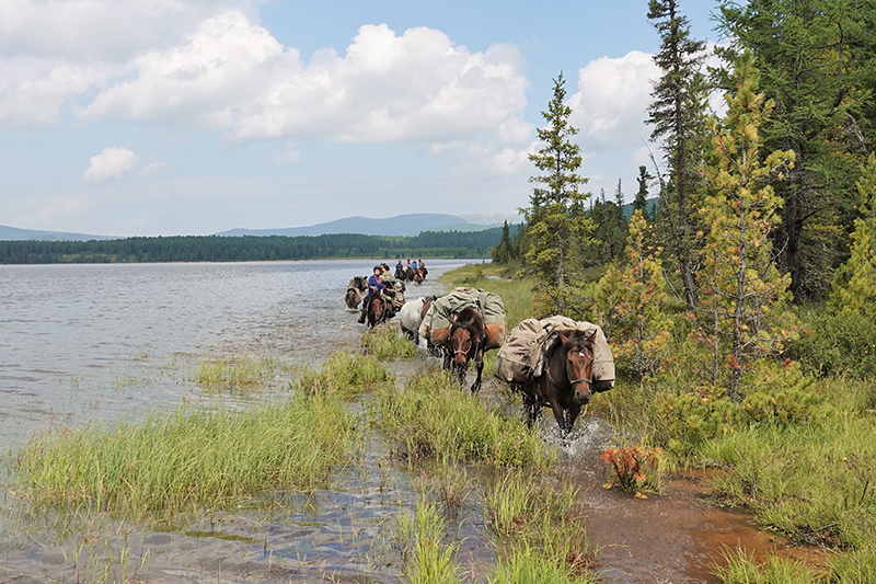 The Stone Horse trek leaving a wilderness lake in the Khentii Mountains