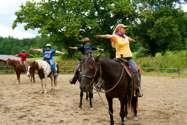 Stretching on Horseback Yoga Poses