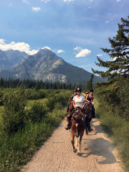 horseback riders on a trail ride in banff national park