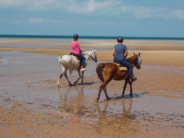 women horseback riding on the beach mozambique horse safari