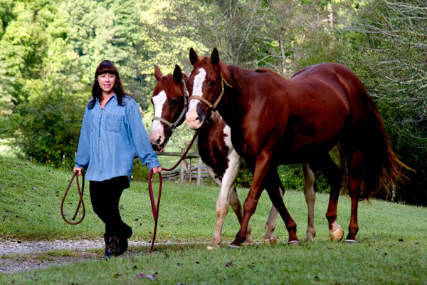 Cathy Woods Yoga Leading Horses